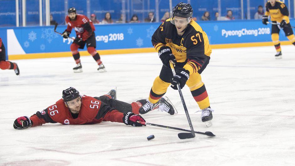 Olympische Winterspiele: Deutschland besiegte Kanada im Eishockey 4:3.
