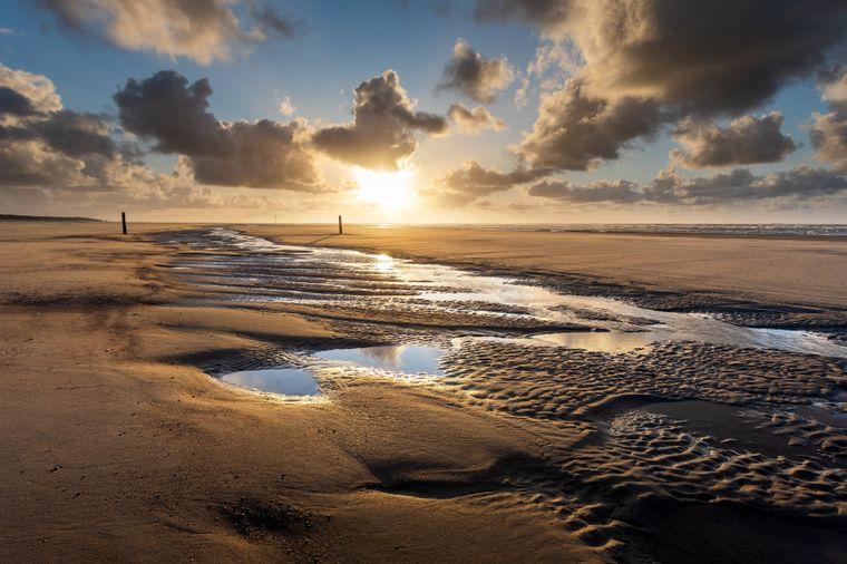 Inspirierende Kulisse: Das ostfriesische Naturschauspiel aus Watt, Wolken und Sonne beeinflusste schon viele Künstler.