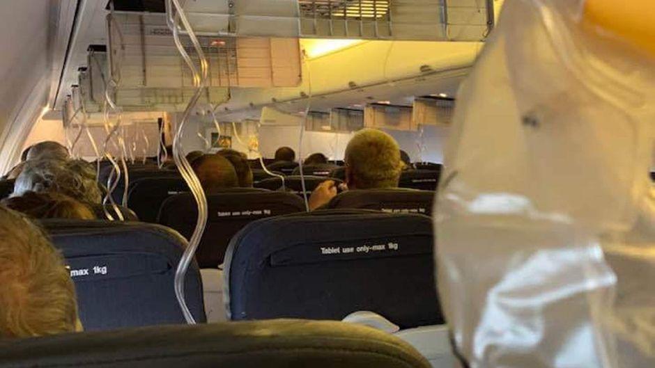 Sauerstoffmasken in einem Qantas-Flugzeug in Australien.