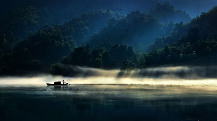Fischer auf einem Fluss in Hunan, China.