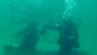 Zwei Taucher vor einer der sieben Skulpturen im Unterwassermuseum in Florida.