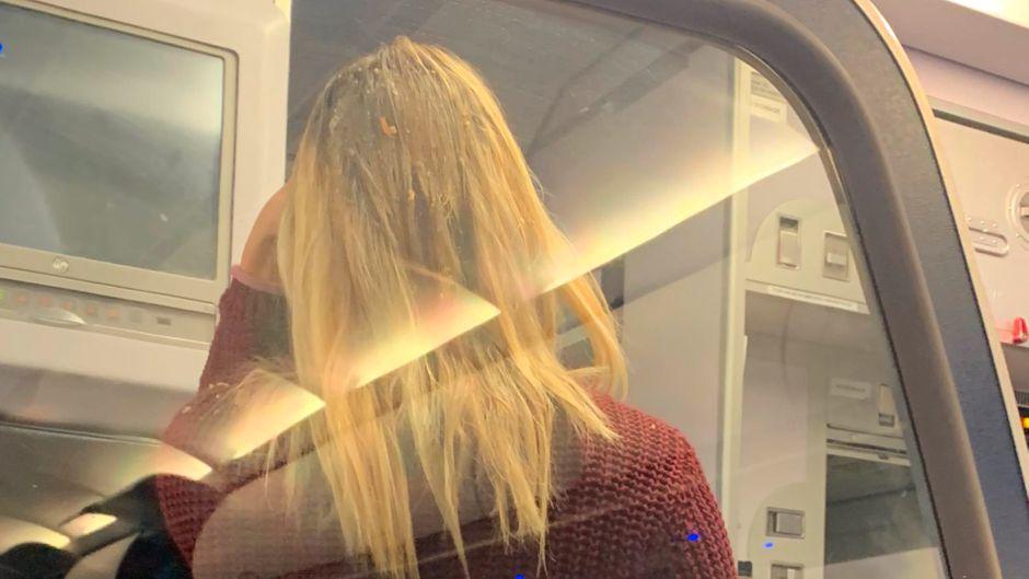 Nein, das im Haar der Passagierin ist keine spezielle Pflegekur.