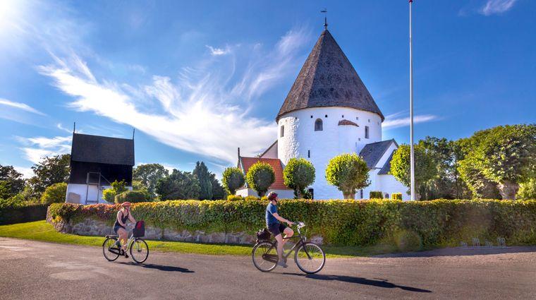 Biking tour past Ols Rundkirke