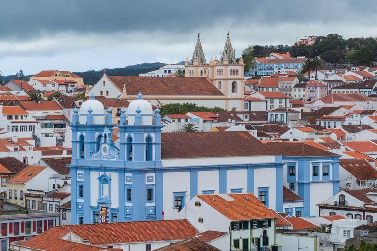 Portugal, Azores, Terceira Island, Angra do Heroismo, elevated town view with Igreja da Misericordia and Santissimo Salvador da Se churches. imago images/Walter Bibikow