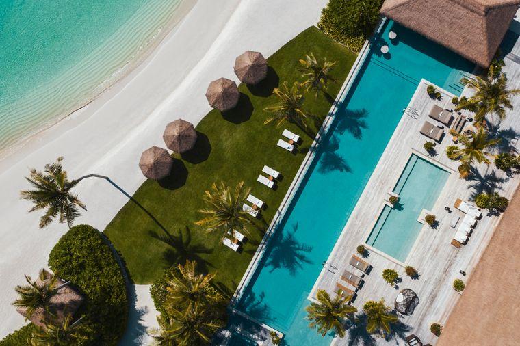 Den Strand vor der Haustür haben: auf dieser Luxusinsel ist das möglich.