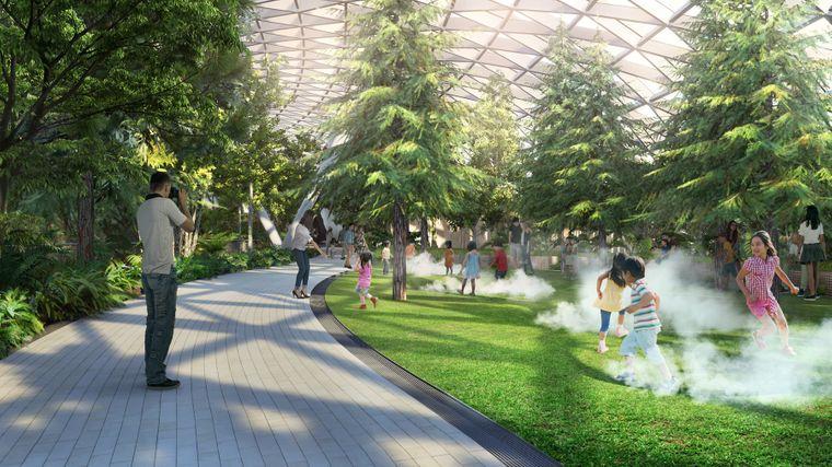 Nebel und spielende Kinder auf Rasen im geplanten Canopy Park im Flughafen Singapur.