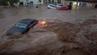 Autos in den überschwemmten Straßen von San Llorenc auf Mallorca.