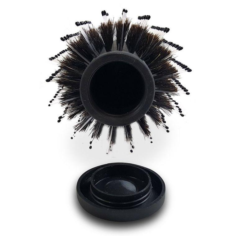 Pflegt die Haare und sichert Bargeld oder Wertsachen: die Bürste mit Versteck.